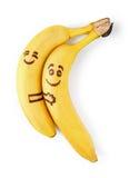 与兴高采烈的面孔,在爱概念的夫妇的香蕉 库存照片