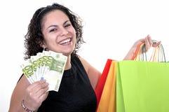 与100欧元票据的妇女购物  免版税库存照片