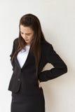 与backpain办公室syndrom的女性商业主管 免版税图库摄影