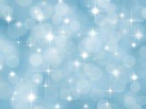 与boke和星形的抽象蓝色背景 免版税图库摄影
