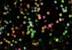 与bokeh光和星的抽象背景 免版税库存图片