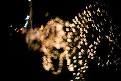 与bokeh光和星的抽象背景 图库摄影