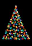 与bokeh光的圣诞树,传染媒介 免版税库存照片