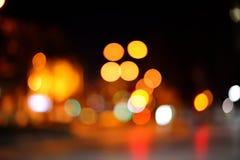 与bokeh光的抽象城市迷离背景 免版税库存照片