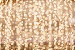 与bokeh光的欢乐抽象背景 金子和蓝色bok 免版税库存图片