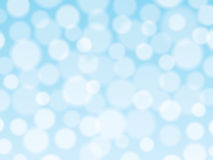 与bokeh光的蓝色背景 免版税图库摄影
