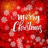 与bokeh和题字圣诞快乐的红色圣诞节背景 免版税库存图片