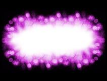 与bokeh的紫色背景框架在黑色点燃 库存图片