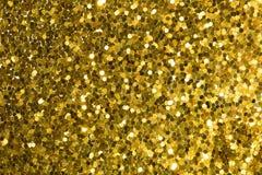 与bokeh,defocused圣诞灯的金抽象背景 库存照片