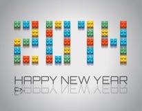 2014与coloful塑料块的新年背景 免版税库存图片
