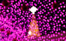 与defocused光的抽象轻的圣诞节庆祝背景 库存图片