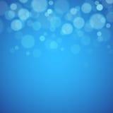 与defocused光的蓝色背景 免版税图库摄影
