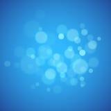 与defocused光的蓝色背景 库存照片