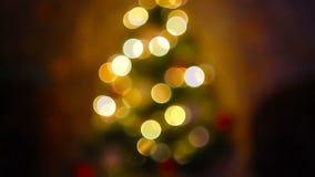 与defocused圣诞树光的抽象背景 库存照片