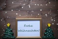 与Frohe Weihnachten的框架意味圣诞快乐,雪花 库存图片