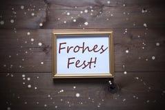 与Frohes费斯特的画框意味圣诞快乐,雪花 免版税库存照片