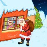 与giftbag的老圣诞老人在圣洁圣诞节期间 免版税库存照片
