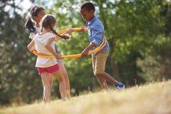 与hula箍的孩子 免版税图库摄影