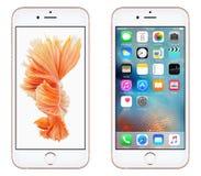 与iOS 9和动态墙纸的罗斯金苹果计算机iPhone 6S正面图在屏幕上 库存图片