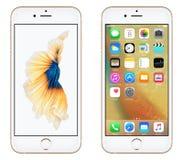 与iOS 9和动态墙纸的金苹果计算机iPhone 6S正面图在屏幕上 免版税库存图片