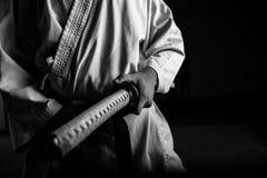 与katana的年轻武术战斗机 库存照片