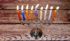 与menorah的犹太假日光明节背景在黑板 图库摄影