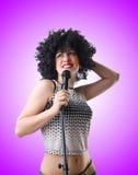 与mic的流行音乐明星在白色 图库摄影