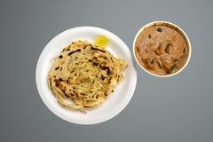与paneer黄油masala食物摄影的喀拉拉paratha 库存图片