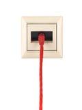 与RJ-45连接器的缆绳被连接到壁装电源插座 库存图片
