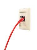与RJ-45连接器的缆绳被连接到壁装电源插座 图库摄影