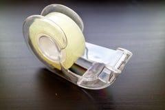 与sellotape的塑料分配器 图库摄影