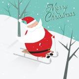 与sledging的圣诞老人的滑稽的圣诞节明信片 免版税库存图片