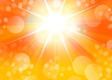 与starburst光和bokeh的橙色画象背景 免版税库存图片