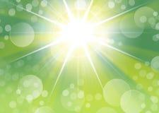 与starburst光和bokeh的绿色画象背景 免版税库存照片