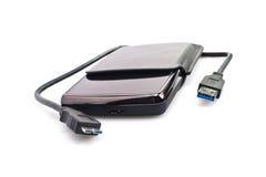 与USB电缆的可移植的光盘 免版税库存图片