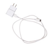 与usb缆绳孤立的适配器充电器在白色(裁减路线) 免版税库存图片