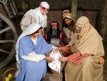 与wisemen的圣诞节场面 免版税库存照片