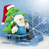 与xmas树的圣诞节圣诞老人 免版税图库摄影