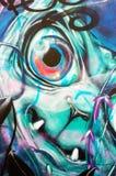 丑恶的面孔街道画墙壁艺术 免版税库存图片
