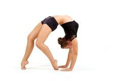 年轻专业体操运动员妇女 免版税库存照片