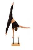 年轻专业体操运动员妇女 免版税库存图片