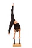 年轻专业体操运动员妇女 免版税图库摄影