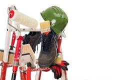 专业房屋油漆工、工具和工作设备 免版税库存图片