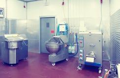 专业肉食品处理设备,被定调子 免版税库存图片