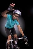 专业自行车运动员挥动的手画象  图库摄影