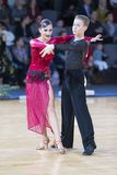 专业舞蹈夫妇执行联盟战利品的青年时期2拉丁美洲的节目 免版税图库摄影