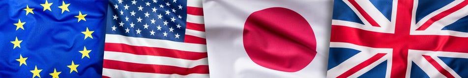 世界下垂概念 四个国家,世界旗子拼贴画  欧盟大英国美国人和日本旗子 库存图片