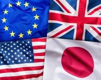 世界下垂概念 四个国家,世界旗子拼贴画  欧盟大英国美国人和日本旗子 免版税库存图片