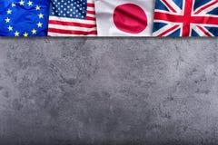 世界下垂概念 四个国家,世界旗子拼贴画  欧盟大英国美国人和日本旗子 免版税图库摄影