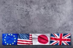 世界下垂概念 四个国家,世界旗子拼贴画  欧盟大英国美国人和日本旗子 免版税库存照片